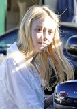 Dakota Fanning | Outside the Maxazria Group in LA | April 27 | 21 leggy pics