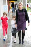 Faith Hill - wearing black tights and shopping w/her kids in Beverly Hills  2/23/08